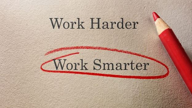 The words 'work smarter' highlighted in red pencil on paper