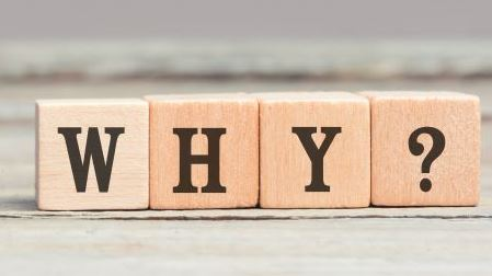 3 wooden blocks spelling out the words 'why'